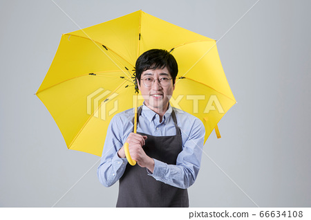 A studio portrait of Asian man making a confident smile 106 66634108