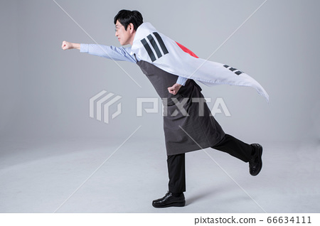 A studio portrait of Asian man making a confident smile 052 66634111
