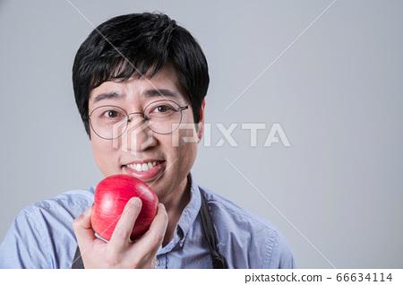 A studio portrait of Asian man making a confident smile 060 66634114