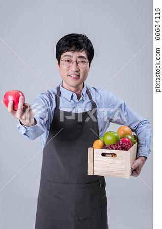 A studio portrait of Asian man making a confident smile 100 66634116