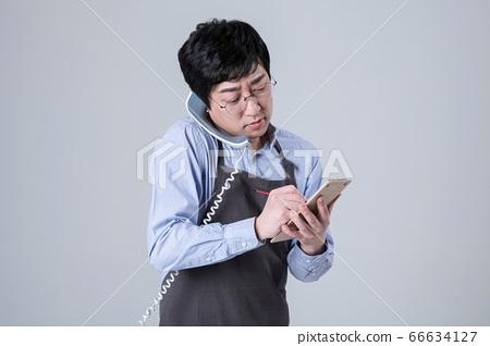 A studio portrait of Asian man making a confident smile 016 66634127