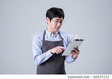 A studio portrait of Asian man making a confident smile 057 66634132