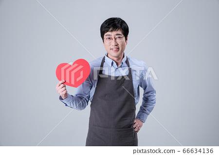 A studio portrait of Asian man making a confident smile 032 66634136