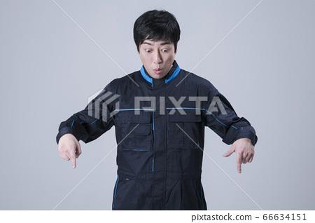 A studio portrait of Asian man making a confident smile 159 66634151