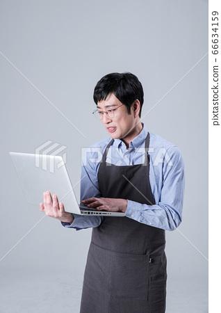A studio portrait of Asian man making a confident smile 026 66634159