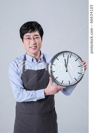 A studio portrait of Asian man making a confident smile 079 66634185