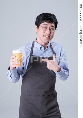 A studio portrait of Asian man making a confident smile 076 66634188