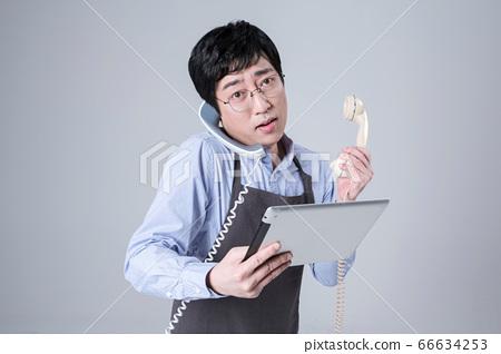A studio portrait of Asian man making a confident smile 029 66634253