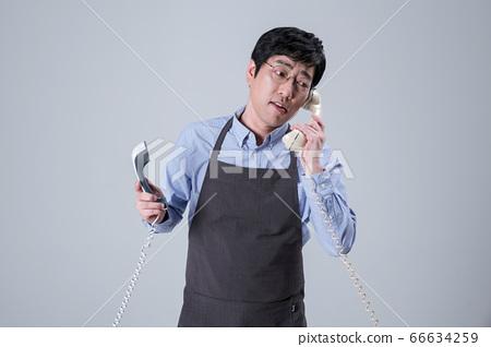 A studio portrait of Asian man making a confident smile 022 66634259