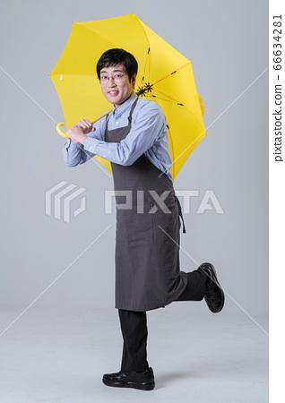 A studio portrait of Asian man making a confident smile 018 66634281