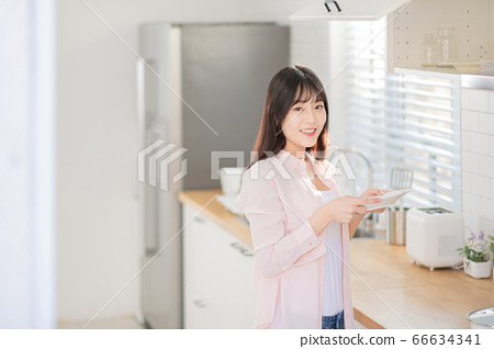 Young asian woman's Daily life concept. Enjoying daily routine 548 66634341