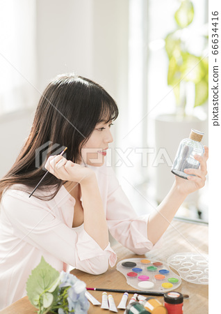 Young asian woman's Daily life concept. Enjoying daily routine 450 66634416