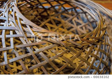 Retro bamboo basket under yellow light 66638102