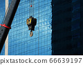 Construction crane With a background of tall buildings 66639197