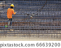 Construction worker And steel bars for tall building structures 66639200