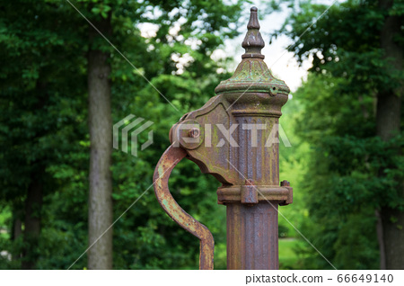 hand water pump. Old Manual pump well in park. 66649140