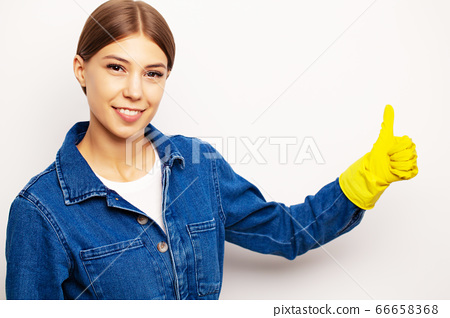 Smiling cleaning worker in special uniform and yellow gloves 66658368