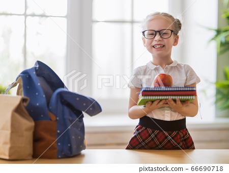 child preparing for school 66690718