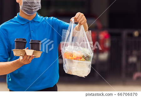 Delivery man wearing face mask making grocery 66706870