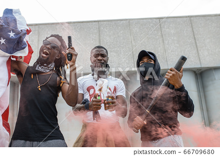 aggressive black people with guns in the streets 66709680