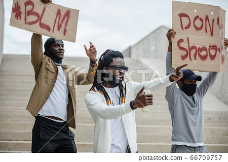 afroamerican people rioting due to racial discrimination 66709757