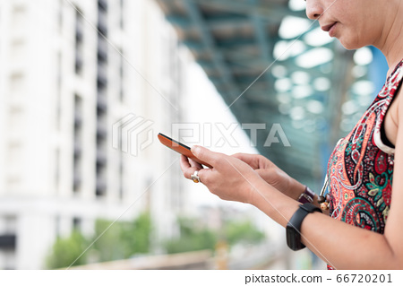 mature traveling woman waiting and using a 66720201
