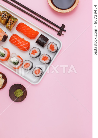 Sushi set with salmon on pink background, top view. 66729434