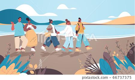 mix race friends walking near river digital detox vacation travel adventure concept 66737375