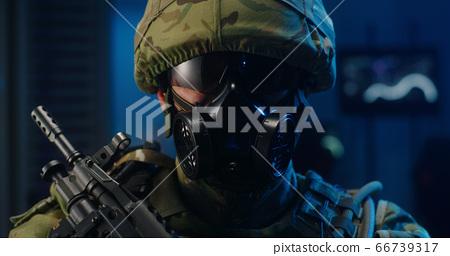 Portrait of soldier in full combat gear 66739317