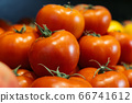 Wet fresh tomatoes on supermarket shelf. Red organic vegetables in grocery store. Healthy vegetarian food, nutrition, dieting. 66741612