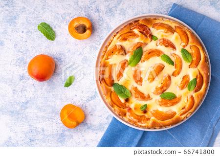 Apricot mascarpone tart, on blue background. 66741800