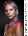 Beautiful girl with multi-colored hair and creative make-up and hairstyle. Beauty face. 66746197