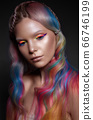 Beautiful girl with multi-colored hair and creative make-up and hairstyle. Beauty face. 66746199