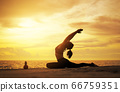 woman practicing yoga during surrealistic sunset 66759351