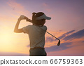 Young Women Asia player golf swing shot on course 66759363