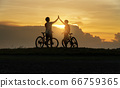 Young Couple in love fun and happy riding mountain 66759365