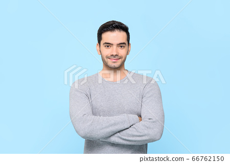Portrait of smiling friendly handsome man in plain 66762150