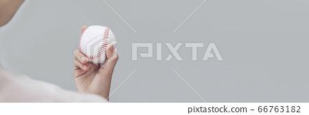 Woman with baseball ball 66763182