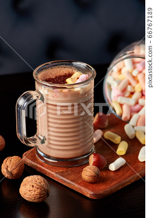 Glass cup of hot chocolate with marshmallows. 66767189
