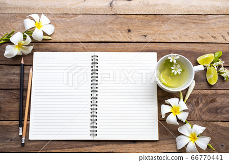 notebook planner for business work with herbal healthy drinks lemonade ,white flowers frangipani 66770441