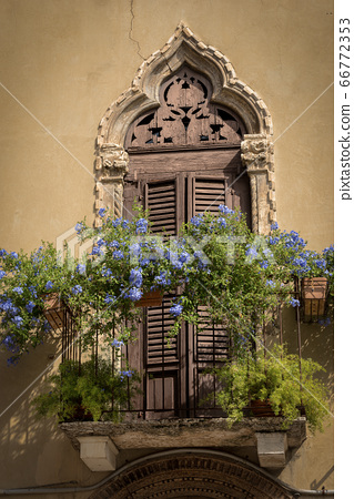 Ancient door with arch in Venetian Gothic style - Verona Italy 66772353