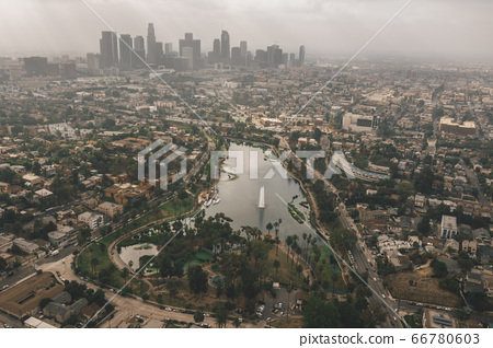 Echo Park in Los Angeles with View of Downtown Skyline and Foggy Polluted Smog Air in Big Urban City 66780603