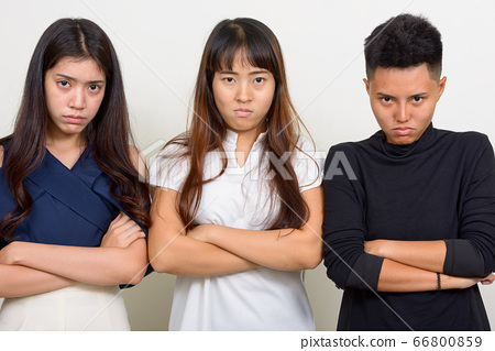 Three angry young Asian women as friends with arms crossed together 66800859