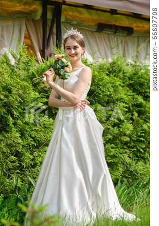 Portrait of pretty bride outdoor near ceremony 66807708