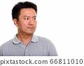 Studio shot of Japanese man isolated against white background 66811010