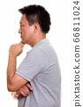 Studio shot of Japanese man isolated against white background 66811024