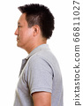 Studio shot of Japanese man isolated against white background 66811027