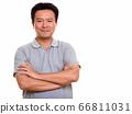 Studio shot of Japanese man isolated against white background 66811031