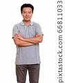 Studio shot of Japanese man isolated against white background 66811033
