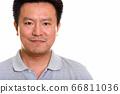 Studio shot of Japanese man isolated against white background 66811036
